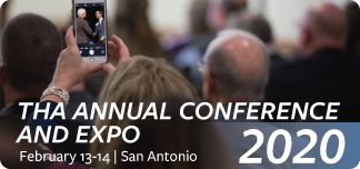 photo of a conference attendee taking a photo with mobile phone