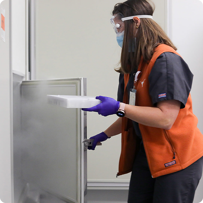photo of an employee at UT Health Austin storing the first shipment of the COVID-19 vaccines; photo courtesy of UT Health Austin, Alyssa Martin, photographer