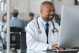 image of a doctor working on a laptop