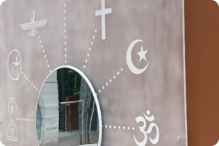 photo of wall art featuring various religious symbols