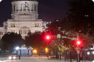 photo of the Texas Capitol building at night during the February snow storm