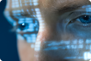 photo of the eyes of a computer hacker