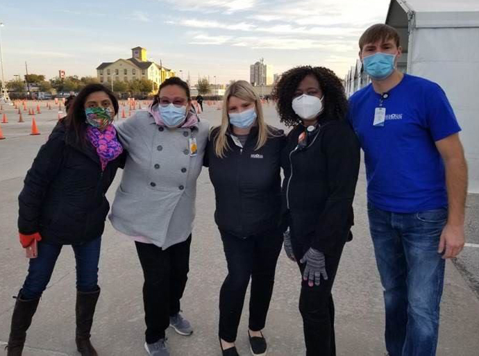 photo of a group of masked volunteers in a parking lot