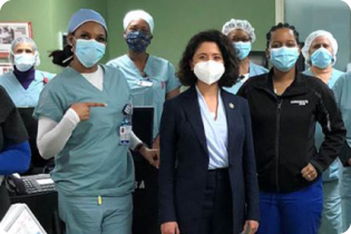 photo of gathered hospital staff in masks