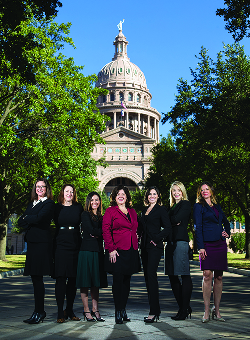 Banda and colleagues standing in a row front of the Texas Capitol building in Austin