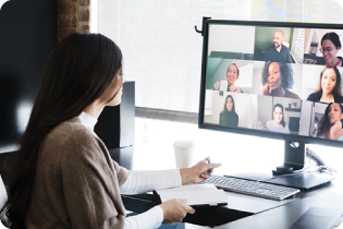 photo of office employee sitting at desk attending a virtual meeting