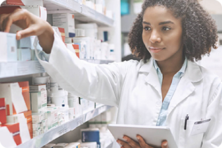 photo of a pharmacist selecting a product from the shelves