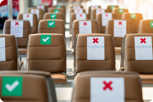 thumbnail of article banner, empty seats on an airplane marked green for those you can sit in, red for those you cannot, for social distancing